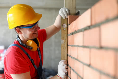 Construction worker ponders the debt to capital ratio